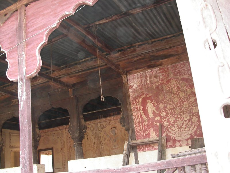 White-on-red Fresco work
